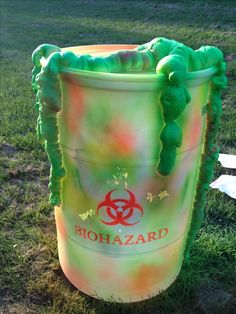 Biohazard halloween prop made from plastic barrel, spray paint, and stencils (bought and made on cricut) :)