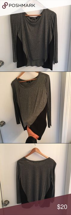 gray 3/4 flowy shirt with sheer paneling 3/4 flowy gray shirt with sheer black paneling Forever 21 Tops