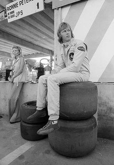 Sixth placed Ronnie Peterson (SWE) Lotus sits on a tyre stack in the pits with his wife Barbro in the background. Brazilian Grand Prix, Rd2, Interlagos, Sao Paulo, 27 January 1974.