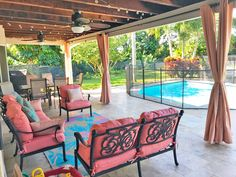 This trendy pool deck is made more comfortable with durable outdoor Sunbrella curtain panels, cushions, and pillows.