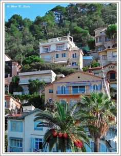 Luxury houses in the slope opposite famous Monte Carlo Casino near the F1 racing road with the well known Turn around the Casino. Monte Carlo which is an administrative area of the Principality of Monaco was founded in 1866. It is widely known for its casino, its prominence and the Formula One Monaco Grand Prix