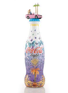 """As the part of its """"Tribute to Fashion"""" charity project, Coca Cola asked some of the best Italian designers to put their stamp on its limited edition bottle, including Moschino, Donatella Versace, Angela Missoni, Alberto Ferreti, Consuelo Castiglioni and Etro, who showcased their creations at the Milano Fashion Centre."""