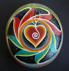 crept into our lives. Sally's painted stone mandala is an engagement present. in Tasmania and Windgrove… Pebble Painting, Pebble Art, Stone Painting, Stone Crafts, Rock Crafts, Dreamcatchers, Mandala Rocks, Stone Mandala, Pierre Decorative