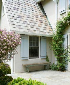 light gray stucco with light blue shutters and shingled roof (i like a darker shade of blue) Stucco Homes, Stucco Exterior, Exterior Design, Exterior Homes, Blue Shutters, Interior Shutters, Exterior Paint Colors, Exterior House Colors, Shutter Colors