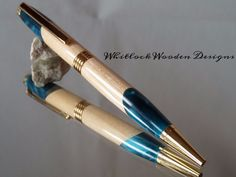 This is a Unique Streamline Handmade Ballpoint Pen turned by me on a lathe in my own workshop. The pen has 24 carat gold plated trim and the pen barrels are are a Hybrid combination of cherry wood and turquoise Acrylic Resin. I have been exploring the possibilities of segmented design although this is a Hybrid it is not caste like the others I have but jointed the wood and Acrylic together. It is difficult to work as the resin is much harder than the wood but very worth the effort. The pen…