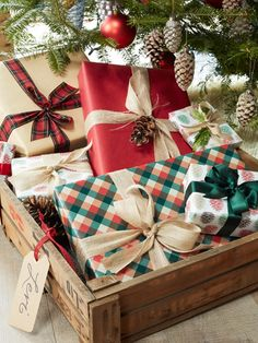 """Marisa Bistany Connecticut Farmhouse - Christmas House Tour - Country Living """"Marisa gives each guest a special delivery on Christmas morning by corralling gifts in tagged shipping crates under the tree."""""""