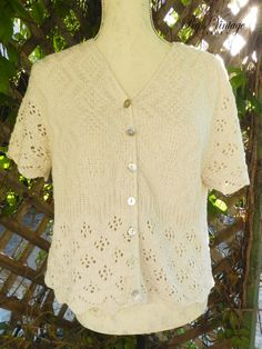 Check out this item in my Etsy shop https://www.etsy.com/ca/listing/462071667/vintage-crochet-short-sleeved-top-1970s