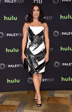 Classic: Actress Bellamy Young wore a strapless white dress with a black v-pattern...