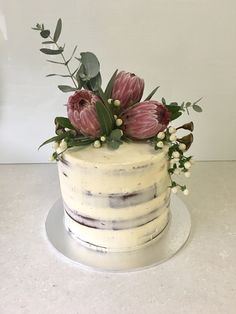 Chocolate mud cake with chocolate buttercream filling. Decorated with proteas and gum.
