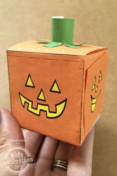 Make your own Jack-o-lantern pumpkin block with this free printable. You can hide treats inside too!