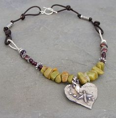 (http://www.elizabethplumbjewelry.com/green-turquoise-and-artisan-heart-necklace/)