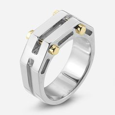 """A VERSATILE RING WITH CONTRASTING RIVET DETAILS. Suggested to be worn stacked or alone. .25"""" wide at top."""
