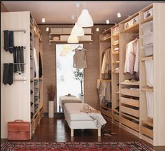IKEA PAX Wardrobe system as a walk-in-closet in a spare room. Nice, functional , good quality and inexpensive :-D