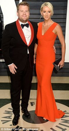 Matchy matchy: Later arriving at the Vanity Fair Oscar party was comedian James Corden and his wife Julia - who put on a truly united front in co-ordinating ensembles of bright orange