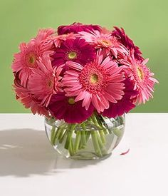 simple but cute center pieces, could even use fake flowers but still include the water for the look