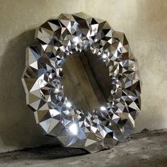 The Stellar Mirror takes inspiration from the physical attributesof cut diamonds.  The mirrors reflective qualities, while crisp andpure at its center, radiate out with a ring of 750 individually sizedand angled mirrored sections, breaking down the light and thesurrounding environment, delivering it to the eye as one sparkling entity. This optical dispersion means that as the ambience of the mirrorsenvironment changes throughout the day, so too does its colorand lustre, creating an ever…
