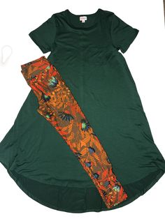 This is a great green dress. It's an XS LuLaRoe Carly dress paired with One Size Leggings. Click to shop with me.