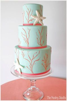"Modern -Wedding Cake in mint green and coral with starfish and coral.....  I don't know if this is ""too much"" but it's a pretty color combo. ??"