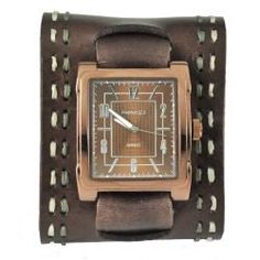 @Overstock - A brasstone stainless steel case hosts a brown gradient dial in this casual watch from Nemesis. Silvertone hands and markers and a wide stitched brown leather cuff strap finish the unique style of this stylish timepiece.http://www.overstock.com/Jewelry-Watches/Nemesis-Womens-Wide-Chocalate-Brown-Leather-Watch/6056124/product.html?CID=214117 $65.99
