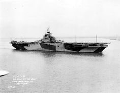 Aerial off the bow view of USS Antietam (CV-36) in camouflage underway off Philadelphia Navy Yard, March 2, 1945.