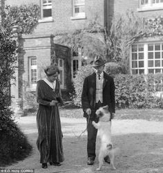 Thomas Hardy and his second wife Florence are pictured outside Max Gate with their dog Wessex in The pooch was buried in the pet's cemetery in the garden in 1926 Book Writer, Book Authors, Jude The Obscure, Pet Cemetery, Madding Crowd, Wire Fox Terrier, Writers And Poets, Mans Best Friend, Pets