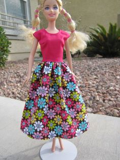 Perfect for Valentines Day or Easter, this dress is durable and modest. Velcro back closure. Doll not included.