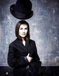 Isabelle Huppert and the oversized #EmporioArmani bowler hat