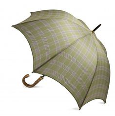 The Prince of Wales Check umbrella is made in England. The beautiful design is based on the set of a traditional Prince of Wales Check. It was chosen by HRH The Prince of Wales, created exclusively for Highgrove and uses soft, subtle colours inspired by the garden.