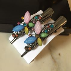 SALE!1 for $7, 2 for $11, 3 for $15-Hair Clips  SALE!  Bejeweled multicolor-light pink, blue, yellow & green beveled butterflies on silver colored hair clips. Very pretty! The price of one set is $7, 2 sets are $11, 3 sets for $15. Choose from different color/ style hair clips. Do not purchase this listing unless you only want this set of beveled multicolor butterfly clips shown in pictures. If you want more than one, please comment and I will make a separate listing for you! Accessories…