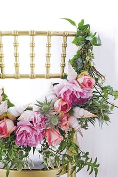 Make a feature of your chair with a stunning garland using flowers, shells and leaves