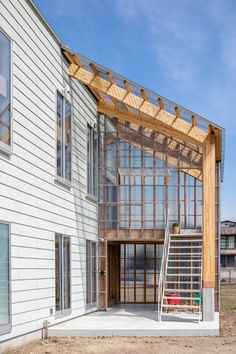 located in central japan, architects SNARK inc. & OUVI have constructed a wooden two-story house equipped with a solarium for cultivating and viewing flora. Studios Architecture, Architecture Details, Interior Architecture, Pole Barn House Plans, Pole Barn Homes, Solarium, Wooden Facade, Tin House, Barndominium Floor Plans