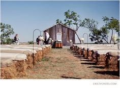 Outside country wedding idea.  I like the way they turned these bales up on their side....not as low to the ground