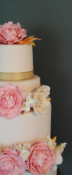 Blush pink wedding cake with pink peonies, ivory roses, white hydrangeas and gold accents. From the Handmade Cake Company