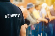 Member of security guard team on public event by stevanovicigor. Member of security guard team working on public event, unrecognizable male person from behind Security Office, Sia Security, Security Guard Companies, Event Security, Security Training, Private Security, Security Service, Security Tips, Visual Basic