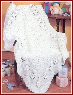 Roses in the Snow baby afghan -- grand prize winner of the 2003 Herrschners Grand National Afghan contest