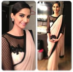 Gorgeous #lace blouse paired with a skin color #sari with black satin border! Designer: #Atsu Sekhose.
