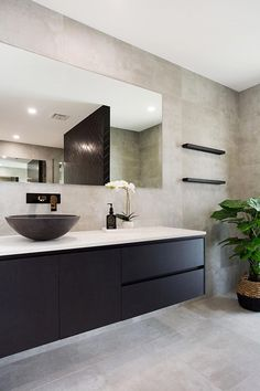 Modern Bathroom using concrete tiles Renovate your bathroom using a modern colour palette, concrete tiles and black vanity, added warmth Black Vanity Bathroom, Modern Master Bathroom, Minimalist Bathroom, Master Bathrooms, Bathroom Mirrors, Bathroom Cabinets, Small Bathroom, Modern Bathrooms, Dream Bathrooms