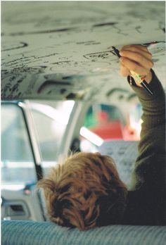 His brain was on overload all the time. A idea would pop in his brain and he had no way to get it out of his head, except by writing. He wrote immediately when it came upon him. Like now, writing on the ceiling of the car at a red light, because there was no paper. He was never like this...What had happened?