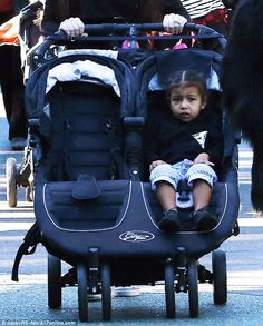 Big day: North rested in her stroller as she celebrated cousins Mason and Reign's birthdays