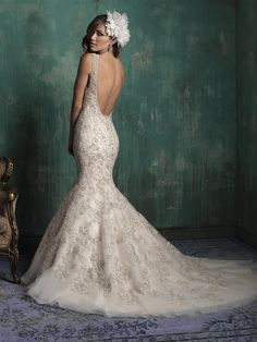 Allure Couture bridal gown. The sophisticated high neckline of this gown leads to a beautifully scooped back and beading.