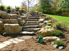 Coming across rock landscaping ideas backyard can be a bit hard but designing a rock garden is one of the most fun and creative forms of gardening there is. Landscaping With Boulders, Landscaping Retaining Walls, Hillside Landscaping, Outdoor Landscaping, Outdoor Gardens, Hillside Garden, Garden Paths, Landscape Design, Garden Design