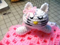 Crochet Kitty Lovie  Part Two...shows how to join amigurumi to blanket...also shows how to embroider face.
