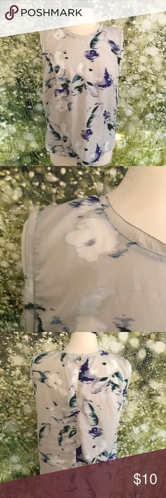 Floral sleeveless blouse Gray blouse with navy and white floral detail and sheer lace detail trim, size large Tops Blouses
