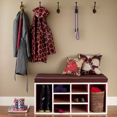 Perhaps redo the front closet in a style like this and create a place to remove shoes or a reading nook?