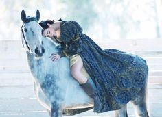 Amazing Dapple grey horse with a lady rider in a gorgeous Renaissance dress.