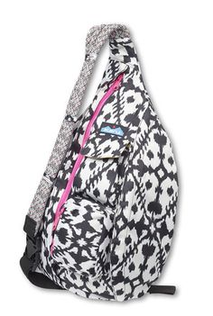 """KAVU&07Rope Sling-Ink Blot-Adjustable rope shoulder strap, two vertical zip compartments, two key or cell phone pockets, padded back with KAVU embroidery. Dimensions: 11"""" x 20"""". Fabric: 600D polyester."""