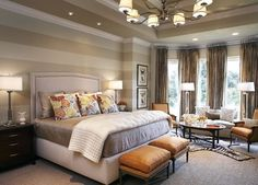 love the light quilt with the darker tan bedding, the colorful pillows and ottomans, and of course the headboard!