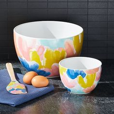 Festooned with vibrant watercolor blooms, this small bowl adds sunny whimsy to your spring baking, especially when combined with the floral Edie rolling pin, spatula and muffin pan. The Edie mixing bowls are also excellent serving bowls, so pair them with the coordinating trivet for a festive spring table. #crateandbarrel #baking #bakingtools #bakingessentials