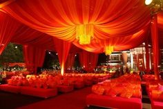 grand and royal decor , red canopy , red cabana , red sofas , red lighting ,  reception and cocktail