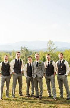 I like the groom in a jacket and the rest in vests